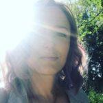 Elle E Kydd outside in sunshine