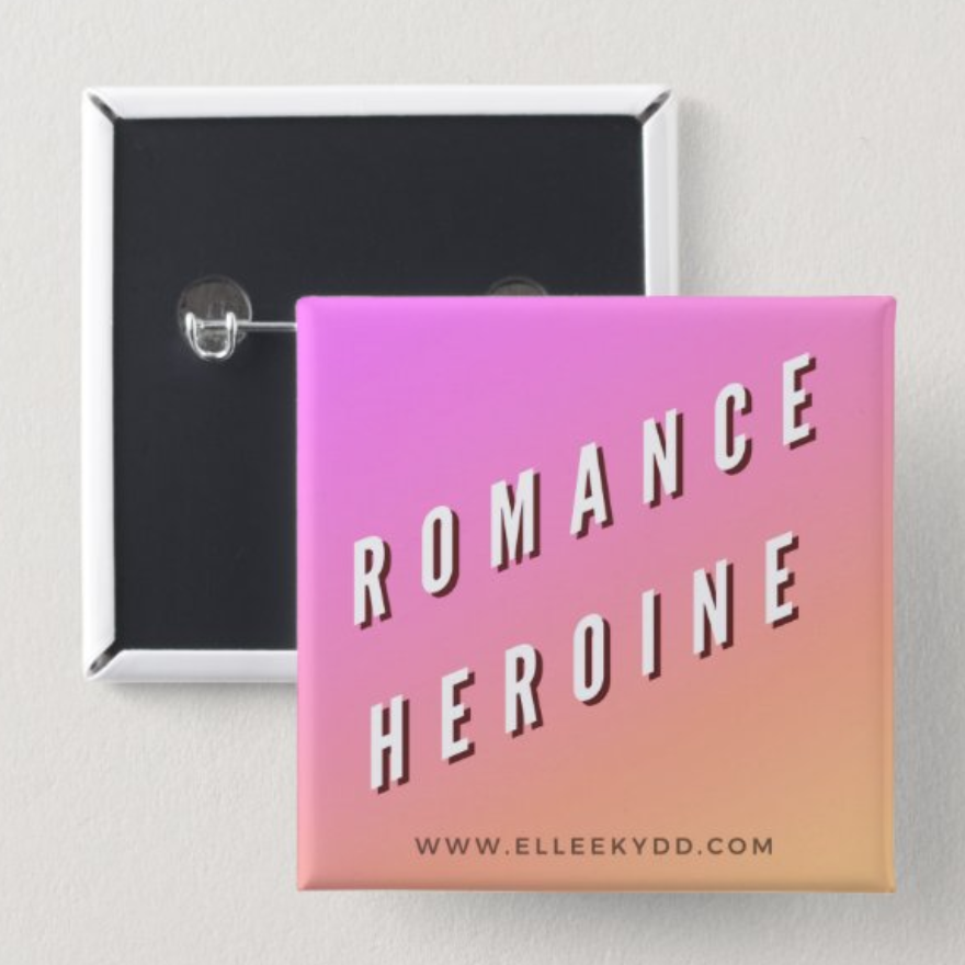 "a square pin that reads ""romance heroine"" and elleekydd.com small at the bottom"