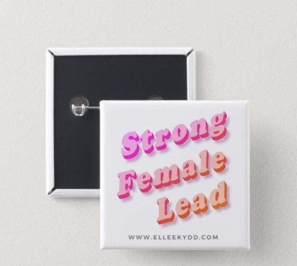 Square metal button that reads 'strong female lead' www.elleekydd.com